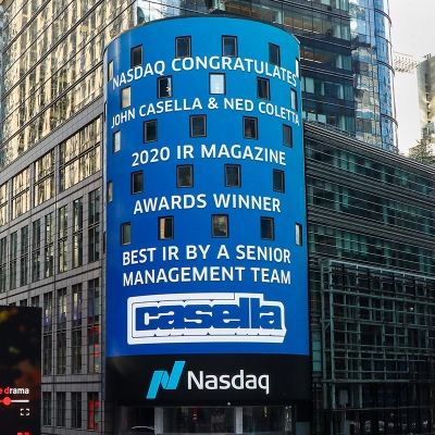 John W. Casella and Ned Coletta honored for their recent award on the Nasdaq Tower.