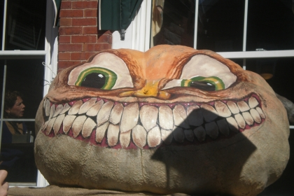 painted pumpkin (it's big) with large eyes and teeth. kinda creepy