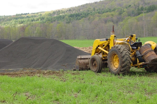 front-end loader in field